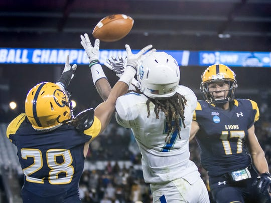 Antoine Griffin (7) goes up to catch a pass over Lions defender Mark Westbrook (28) on Dec. 16, 2017, during the University of West Florida vs. Texas A&M-Commerce NCAA Division II National Championship game at Children's Mercy Park in Kansas City, Kansas.