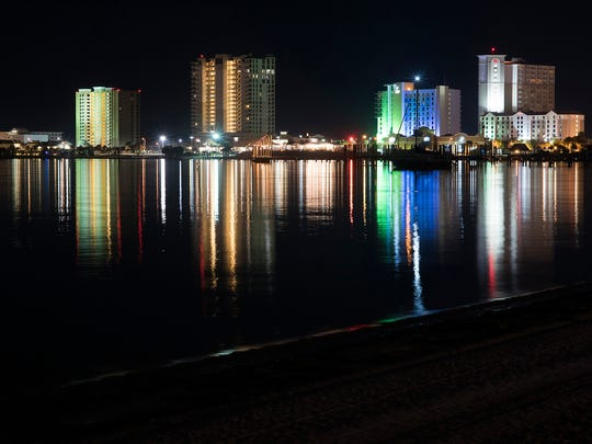 Pensacola Beach comes to life with a multitude of colored lights Tuesday, Nov. 28, 2017.  Escambia County Official are striving to make Pensacola Beach and another surrounding shorelines turtle friendly with the adoption of turtle-safe lighting.