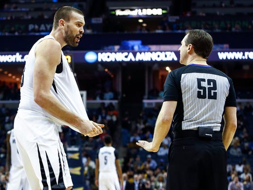 Memphis Grizzlies center Marc Gasol (right) argues