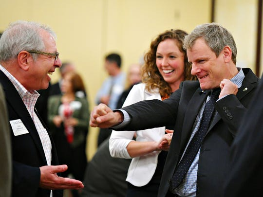 From left, Elliott Weinstein, of Weinstein Realty Consultants, Katie Mahoney, of York County Economic Alliance and York City Mayor Michael Helfrich prior to the York County Economic Alliance hosts its Spring Legislative Luncheon at Wyndham Garden York in West Manchester Township, Thursday, May 17, 2018. Dawn J. Sagert photo