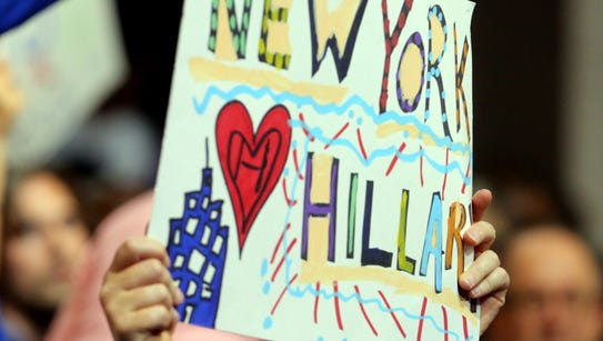 A Hillary Clinton sign is held aloft during the second