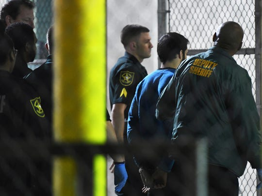 Esteban Santiago, 26, the suspect in the deadly shooting at Fort Lauderdale-Hollywood International Airport, is transported to the Broward County Main Jail by authorities, Saturday, Jan. 7, 2017. The gunman who fatally shot several people and wounded others on Friday in Fort Lauderdale's airport sent panicked passengers running out of the terminal and onto the tarmac with bags in hand.