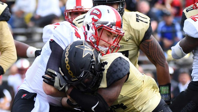 Nov 4, 2017; Nashville, TN, USA; WKU Hilltoppers  quarterback Mike White (14) runs for a touchdown before being hit by Vanderbilt Commodores safety Ryan White (14) during the first half at Vanderbilt Stadium. Mandatory Credit: Christopher Hanewinckel-USA TODAY Sports