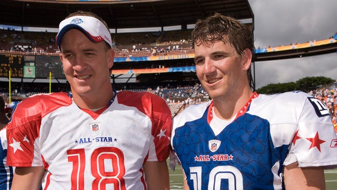 Peyton, left, and Eli Manning, shown in February 2009, probably would prefer a Pro Bowl atmosphere to what they're facing this week.