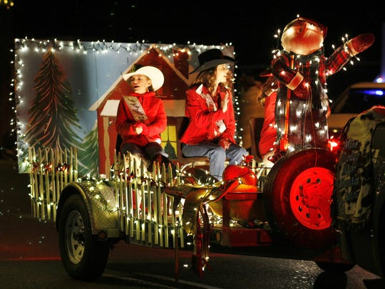 Two cowgals waved to the crowd at the Festival of Lights