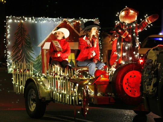 Two cowgals waved to the crowd at the Festival of Lights Parade.