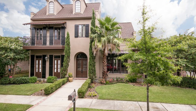 This 5 bedroom, 5 1/2 bath home has 4,704 square feet of living area and is located at  200 Ravenswood Lane in River Ranch. It is listed at $1,450,000.