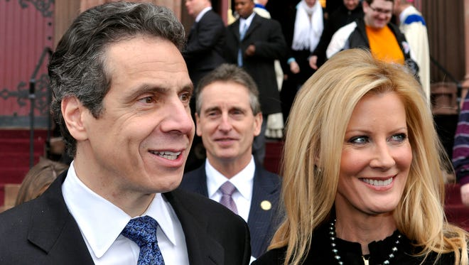 Gov. Andrew Cuomo, left, with his girlfriend, Sandra Lee, and Lt. Gov. Robert Duffy in front of the Cathedral of the Immaculate Conception in Albany, after attending Sunday services Jan. 2, 2011.