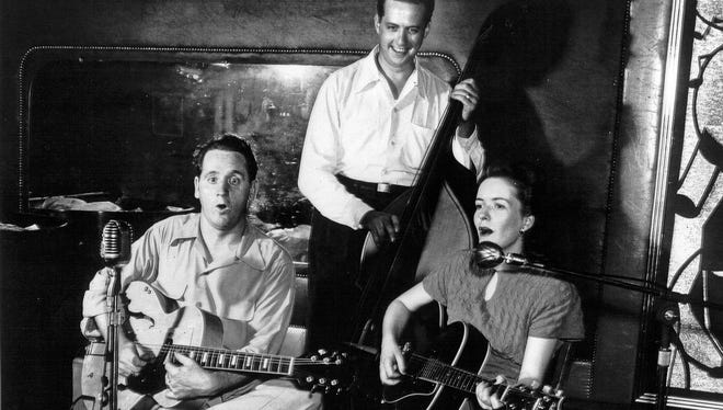 Les Paul and Mary Ford perform at Club 400 in 1949 with Warren Downie playing bass. According to the Les Paul Foundation, it was the first time Paul and Ford performed together in public.