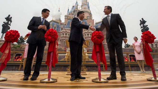 SHANGHAI (June 16, 2016) – Thousands of invited guests celebrated the Grand Opening of Shanghai Disney Resort today with the help of a flood of Shanghai Disney cast members and Disney character friends. Bob Iger, chairman and CEO of The Walt Disney Company (right) joined Chinese CPC Politburo members Wang Yang, State Council Vice Premier (middle), and Han Zheng, Party Secretary of Shanghai (left), to officially open the resort's new theme park, Shanghai Disneyland, at the iconic Enchanted Storybook Castle. At the dedication ceremony,six performers wearing enormous, colorful flags represented the six lands of Shanghai Disneyland: Adventure Isle, Gardens of Imagination, Fantasyland, Mickey Avenue, Tomorrowland and Treasure Cove. Shanghai Disney Resort is a world-class family entertainment destination, imagined and created especially for the people of China. The resort consists of Shanghai Disneyland, a theme park with magical experiences for guests of all ages; two richly themed hotels; Disneytown, an international shopping, dining and entertainment district; and Wishing Star Park, a recreational area with peaceful gardens and a glittering lake. Shanghai Disney Resort is a joint venture between The Walt Disney Company and Shanghai Shendi Group comprised of two owner companies (Shanghai International Theme Park Company Limited and Shanghai International Theme Park Associated Facilities Company Limited) and a management company (Shanghai International Theme Park and Resort Management Company Limited).   (Matt Stroshane, photographer)
