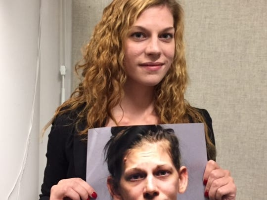 Amanda Bridge of High Bridge, displays a photo taken two years ago when she was arrested for drug addiction.