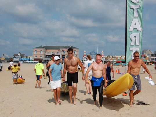 Swimmers and their kayaker support making way to the 9 mile start.jpg