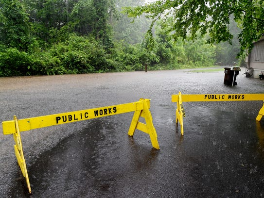 Flat Creek in Black Mountain caused people off of Portman