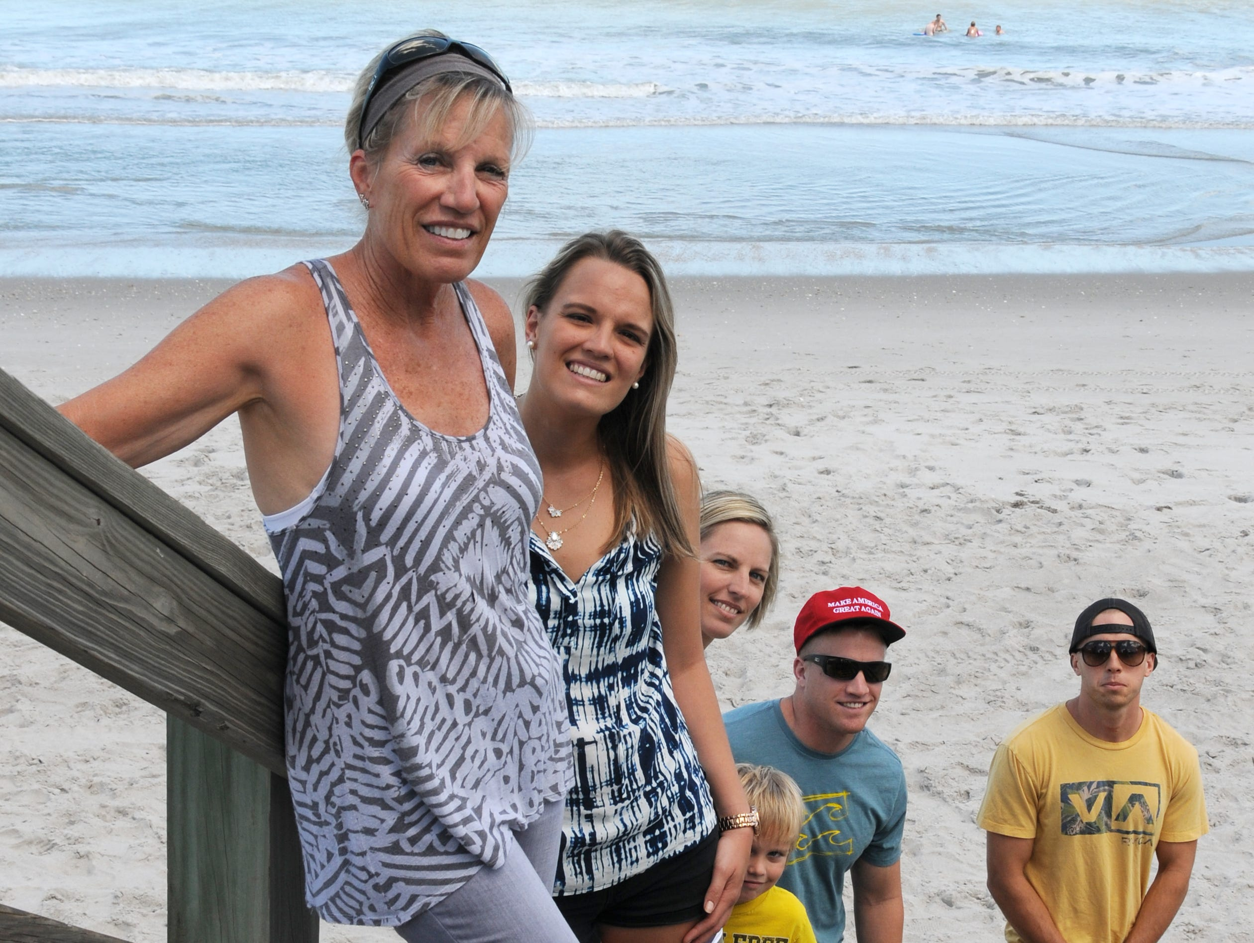 Linda Anderson and her children: daughters Madison Smith and Tiffany Brown, grandson Bodhi Brown, sons Mason Smith, and Calvin Smith walk the beach in Satellite Beach Saturday afternoon.