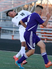 Aztec's Gabriel Vargas, left, and Miyamura's Isaiah Murrilo collide on Thursday at Fred Cook Memorial Stadium in Aztec.