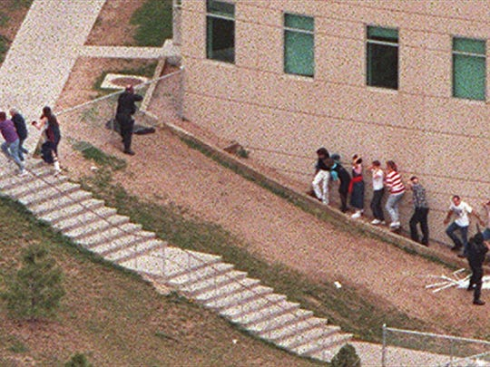 An aerial view shows students being led from Columbine High School in Littleton, Colorado, during the 1999 shootings. It's now been 20 years since Eric Harris and Dylan Klebold killed 12 students and a teacher, and wounded at least 20 other people before dying by suicide. The tragedy has been the impetus for national discussions on everything from school security to gun accessibility to childhood bullying.