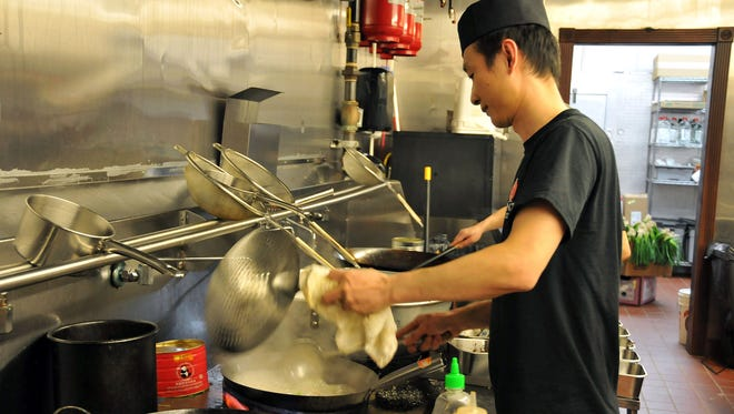 Tony Ye cooks at Ginza, formerly Pattaya, on Tuesday evening.