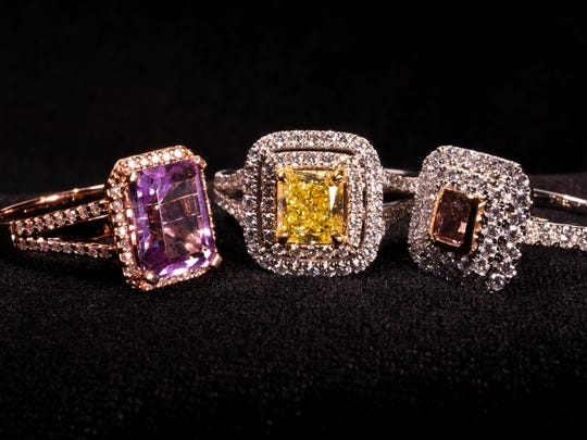 A trio of colorful gemstones, each surrounded by an arrangement of white diamonds as photographed at Vince Jewelers in East Hagåtña on Thursday, Jan. 26, 2017. Center stones are, from left: a 2-carat amethyst, a 1-carat princess cut yellow diamond and a 0.25-carat Pink diamond set in the last.