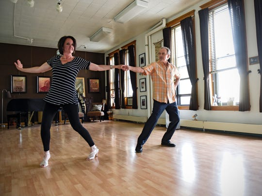 """Melinda Vonderahe and Steve Strang work through a portion of their dance Thursday, May 4, in St. Cloud for their upcoming performance in the Women's Fund of the Central Minnesota Community Foundation """"Dancing With Our Stars Live!"""" fundraiser."""