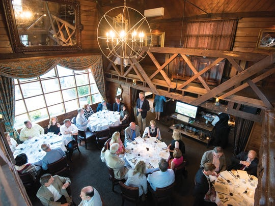 Diners enjoy food and wine pairings at the Saddle River Inn.