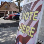 """A """"Vote Here"""" sign outside the Poughkeepsie Library in the City of Poughkeepsie on Tuesday."""
