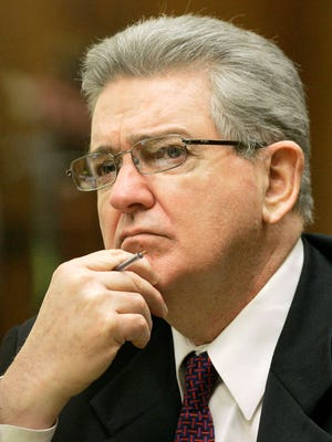 In this Oct. 15, 2008 file photo, former FBI agent John Connolly listens to the testimony of Thomas Daly in Miami. Last year a three-judge panel of the 3rd District Court of Appeal toss out John Connolly's second-degree murder conviction and 40-year prison sentence. Florida state prosecutors persuaded the full 10-judge court to reconsider and oral arguments were held Thursday, Feb. 12, 2015 in Miami. A decision is likely weeks or months away and further appeals are possible.