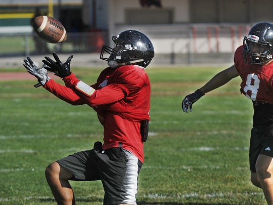 Jesus Olguin grabs an onside kick at a Rio Mesa practice