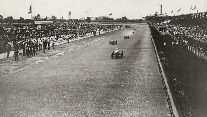Cars go into the first turn as seen from the starter's perch above the track during the 1932 Indianapolis 500.