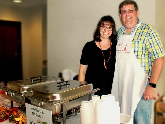 Waynesboro vice mayor Terry Short and his wife, Heather Short, pose for a photo at the 2017 Men Who Cook event on Saturday, Oct. 21, 2017, in Waynesboro, Va.