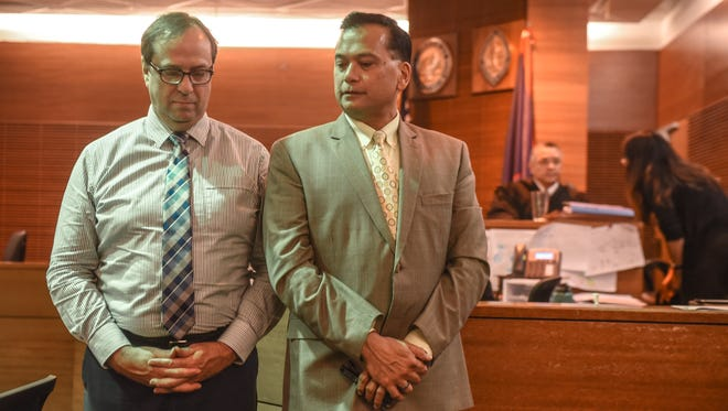 """In this July 27, 2017, file photo, University of Guam professor Michael Ehlert, left, stands with his attorney, Joaquin """"Jay"""" Arriola Jr., as they wait for jurors to enter during Ehlert's sexual assault trial at the Superior Court of Guam in Hagåtña."""