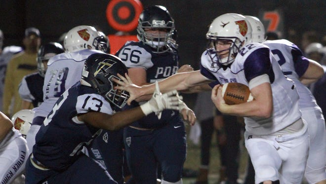 Father Ryan's Jackson Byrd gives the stiff arm to Pope John Paul II's Dallas Darden on Fri. Nov. 3, 2017.  Photo by Dave Cardaciotto