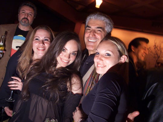Actor Frank Vincent poses with the singing group Mynx