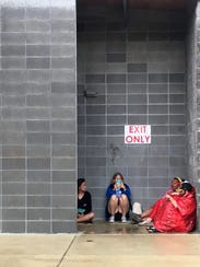 People take shelter in bathroom exit at the Bonnaroo