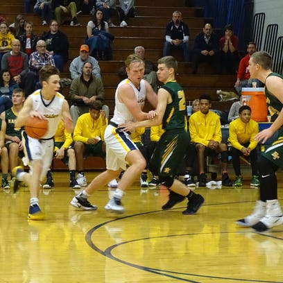 Lancaster's Jacob England drives to the basket as Rocky