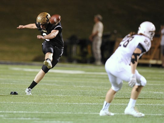 Abilene High kicker Jonathan Manry (3) kicks off during the second quarter of the Eagles' 59-21 win on Thursday, Oct. 27, 2016, at Shotwell Stadium.
