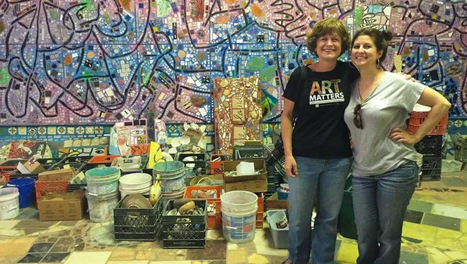 Holly Strayer, left, and Melissa Deekan, at a workshop in Philadelphia where they learned mosaic-mural artist Isaiah Zagar's installation method for the Chambersburg Mural Project.
