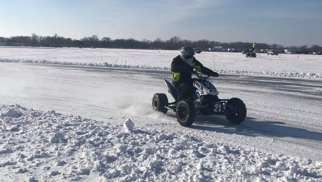 Adam Pollock races in the Quads division on Jan. 7 on Trace Lake near Grey Eagle.