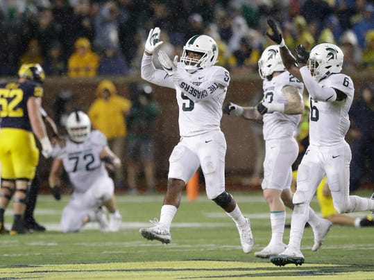 Michigan State linebacker Andrew Dowell (5) and safety David Dowell (6) celebrate after an interception during the second half of an NCAA college football game against Michigan, Saturday, Oct. 7, 2017, in Ann Arbor, Mich. Michigan State won 14-10. (AP Photo/Carlos Osorio)