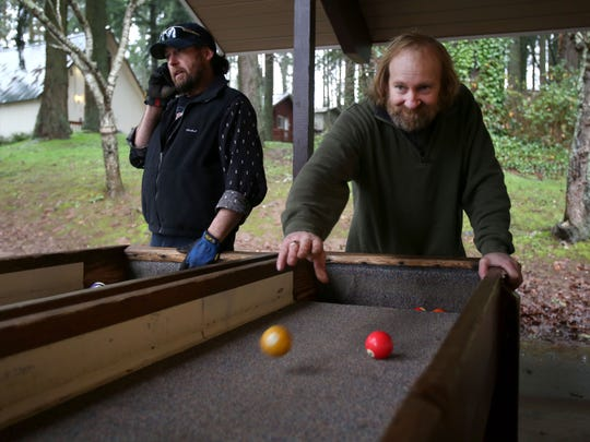 Eric Coalman, right, and Dwight Sjaaheim enjoy the afternoon during a retreat over Christmas at Aldersgate Camp in Turner, Ore on Wednesday, Dec. 24, 2014.