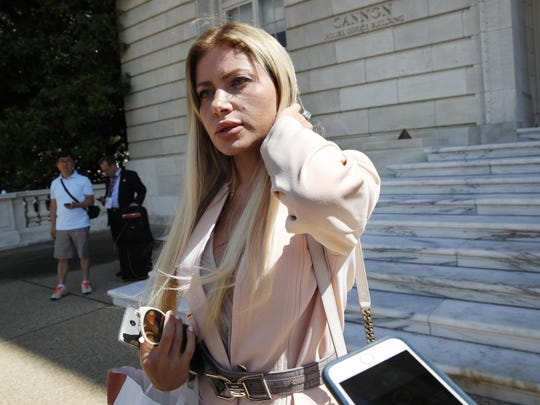 Simona Mangiante Papadopoulos, wife of former Donald Trump campaign adviser George Papadopoulos, speaks to members of the media after attending a closed-door meeting with Democrats on the House intelligence committee, Wednesday, July 18, 2018, on Capitol Hill in Washington. George Papadopoulos pleaded guilty last year to lying to investigators about his contacts with people linked to Russia during the campaign.