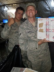 Members of the military visit a care package wrap party