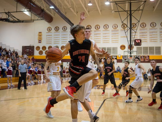 Southridge's Joe LaGrange (20) makes a pass against Gibson Southern during their game at Gibson Southern on Feb. 1, 2018.