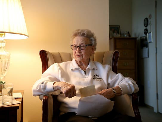 Lillian Baur talks about her family's ties to the Roxy  at her Bremerton apartment on Wednesday.