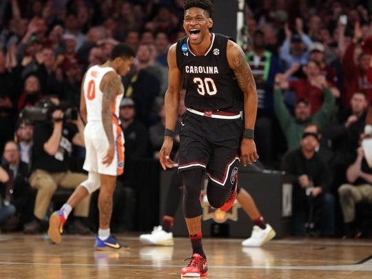 South Carolina Gamecocks forward Chris Silva (30) celebrates during the second half against the Florida Gators in the finals of the East Regional of the 2017 NCAA Tournament at Madison Square Garden.