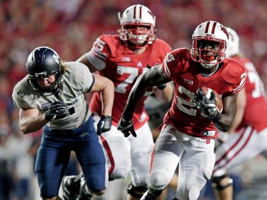 Wisconsin running back Montee Ball breaks away for