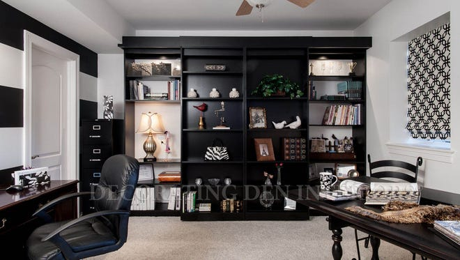 A shelving unit does double duty in a second bedroom.