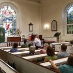 Rebecca Wilson of the Old Swedes Foundation leads a News Journal/Delawareonline Insider tour for subscribers Saturday at Holy Trinity (Old Swedes) Church in Wilmington, which has seen service over five centuries.