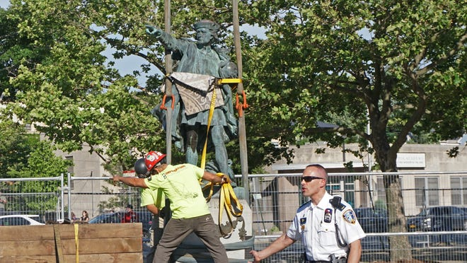 The statue of Christopher Columbus is removed from its site at Elmwood and Reservoir avenues in Providence and loaded onto a flatbed truck on Thursday. The city will consult with a local board to determine its fate.