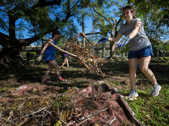 Amanda Plummer, of Fort Myers, volunteers Saturday morning at the Alliance For The Arts campus to help clear debris and brush created after the effects of Hurricane Irma.