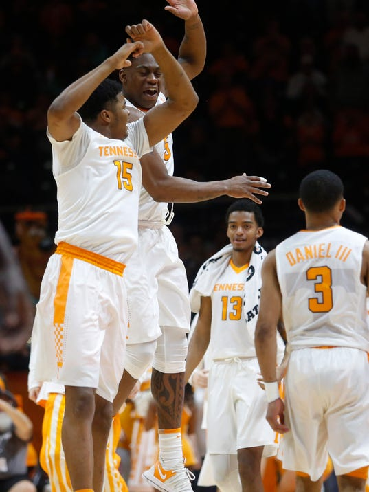 Tennessee forwards Derrick Walker (15) and Admiral Schofield (5) celebrate a basket against LSU during the second half of an NCAA college basketball game Wednesday, Jan. 31, 2018, in Knoxville, Tenn. (AP Photo/Crystal LoGiudice)
